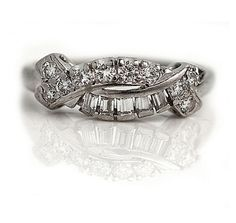 This mid-twentieth century diamond wedding band, crafted in platinum, features five vintage baguette diamonds and ten sizzling round diamonds weighing approximately carat. Platinum Diamond Wedding Band, Diamond Wedding Rings, Wedding Bands, Deco Engagement Ring, Antique Engagement Rings, Round Cut Diamond, Round Diamonds, Wedding Rings Vintage, Vintage Diamond