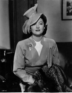 Myrna Loy, Shadow of the Thin Man. (Not many women could look stunning in that hat.)
