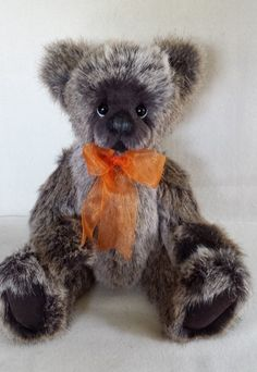 Olav, what a fun bear. His fur is made of German synthetic. The tips are white with a chocolate brown undercoat.