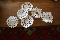 cupcake liner snowflakes.  very pretty with cupcake liners that have designs on them.