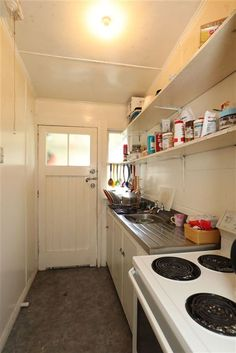 Original kitchen of a NZ Railway Cottage. New Zealand Houses, Kitchen Cabinets, Kitchen Appliances, Cottage Ideas, Old And New, Kiwi, Cottages, Building A House, Buildings