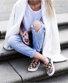 leopard print sneakers with boyfriend jeans and a white coat