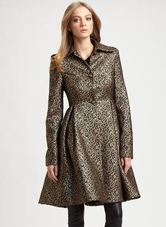 Between the gold metallic brocade and fit-and-flare shape, this Alice   Olivia Connie Metallic Flounce Coat ($798) is a perfect option for the more ladylike-inclined.