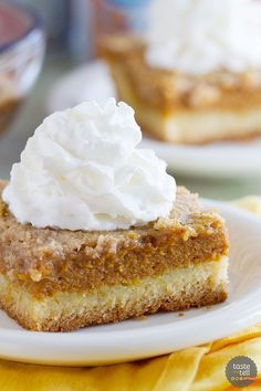 A favorite holiday staple turned into an easy and delicious cake! This Pumpkin Pie Cake has a cake crust with a creamy pumpkin center and a crunchy topping - a favorite the whole family loves!: