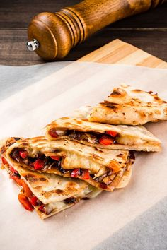 30 mins. · Serves 4 · Sink your teeth into these loaded Vegetarian Quesadillas packed with plant-based chicken, refried beans, and gooey cheeses for a hearty meal! Try this healthy Mexican dish delight with this recipe. #Recipes #Food #Crave #Tasty #Yummy #Delicious #FoodTrip #FoodLover #Recipes.net #foodporn #Cook #Cooking #Foodie #foodblog #homemade #healthyrecipes #mexicancuisine Vegetarian Quesadilla, Quesadilla Recipes, Wrap Recipes, Refried Beans, Mexican Dishes, Meals For One, Tasty Dishes, Cravings, Food Porn