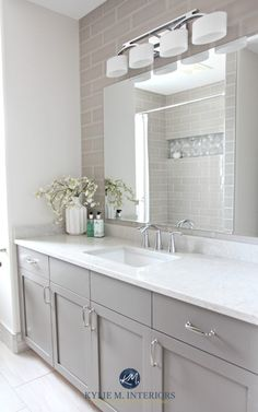 Bathroom remodel, Moen Glyde fixtures, Bianco Drift quartz countertop Caesarstone, subway tile wall, Gray painted vanity by Kylie M Interiors