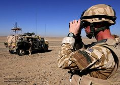 A soldier from 3 Squadron Royal Air Regiment surveys the terrain whilst on patrol with a Panther Protected Command Vehicle outside Camp Bastion, Afghanistan.