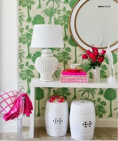 Large print green wallpaper, hot pink accessories, and blanc de chine accents look gorgeous together.