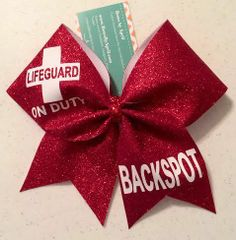 Bows by April Express - Red Glitter LIFEGUARD Backspot Cheer Bow, $18.00 (http://www.bowsbyaprilexpress.com/red-glitter-lifeguard-backspot-cheer-bow/)