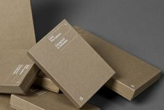 White silkscreen print on cardboard (Unit Portables — Kurppa Hosk)