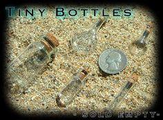 Tiny glass bottles with cork stopper