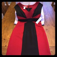NWT Maggy London Red and Black Dress! NWT Maggy London Red and Black Dress! The dress is lined. 97% polyester and 3% spandex. Dry Clean Only. Maggy London Dresses