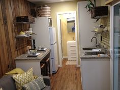 Interior of a 20 foot shipping container home, compact but comfortable with all the essentials.