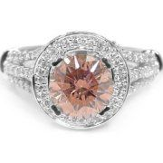 I think this is Morganite? Almost like a peach diamond, so pretty