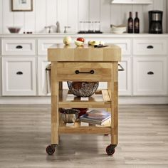 The Marston Butcher Block Kitchen Cart from Crosley is a sturdy, wooden cart that seamlessly fits into nearly any kitchen with its ample storage and elegant design.