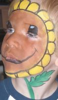 Look Mom, I'm a sunflower! Plants vs. Zombies Face Paint.
