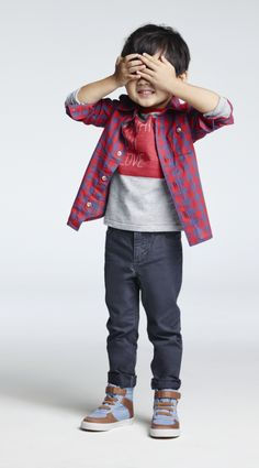 What's red and blue and cute all over? Our Old Navy toddler boys spring collection. Get your little guy red-dy for spring with this cool color combo. Start with the gingham plaid shirt, add the striped short-sleeve crew tee, and pair with his favorite toddler boys jeans and chambray canvas hi top sneakers to complete the look.