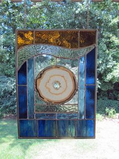 Amber Wave is approximately inches wide x inches tall and contains a large round natural agate -- approximately inches in diameter. Stained glass colors include various shades of blue, amber and clear texture. Stained Glass Flowers, Stained Glass Designs, Stained Glass Panels, Stained Glass Projects, Stained Glass Patterns, Stained Glass Art, Mosaic Glass, Tiffany Stained Glass, Tiffany Glass
