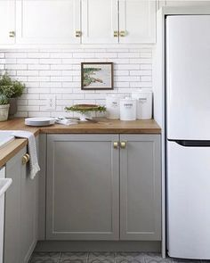 Small Kitchen Remodel Before and After — Amanda Katherine Before & After: Small Kitchen Renovation Reveal — Amanda Katherine New Kitchen Cabinets, Diy Kitchen, Kitchen Decor, Gray Cabinets, Kitchen Ideas, Kitchen Grey, White Appliances In Kitchen, Kitchen Wood, Two Tone Cabinets
