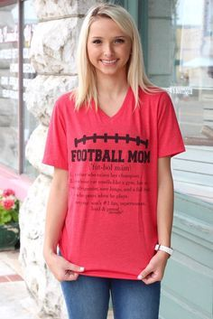 """Football Mom definition v-neck tee. Short sleeve, fitted women's fit tee. Super soft.  """"1. A mother who raises her champion. 2. Whose car smells like a gym, has an empty refrigerator, sore lungs, and a full heart. 3. One who prays when he plays. Synonyms: son's #1 fan, superwoman, loud & proud."""""""