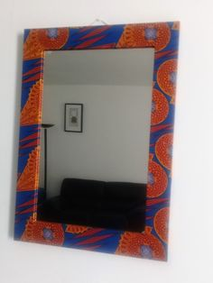 Next  Fabric Covered Mirrors   Fabric Covered Mirrors   Fabric Covered MirrorsFabric Covered Mirrors Add colour to your space with these gorgeous handmade African Dutch Wax Fabric mirrors.The perfect pop of colour for your wall, book shelf or night stand! Mix and match to create your own chic look!   Measurements: 60 x 40 mirror and 8 cm frame. Color Pop, Colour, Night Stand, Fabric Covered, Your Space, Bookshelves, Mirrors, Dutch, Create Your Own