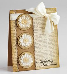 Vintage Flower Wedding Invitation  Design by Lucy Abrams  Arrange a group of three embellishments down the side of your card for a simple, yet elegant, look.  Editor's Tip: Patterned paper featuring text printed in another language adds a sophisticated feel to any design.