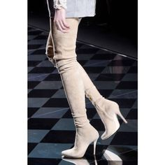 Thigh-High Boots - Made to stand out, second-skin boots cut up to there are a seasonal hit. Bonus: the skin-tight fit easily layers beneath dresses, pants and skirts in chillier temps.