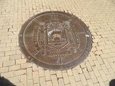US Naval Academy Bronze Crest sunk into the sidewalk