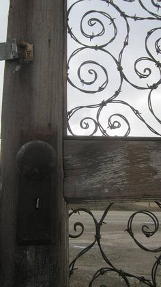 Spirals of Barbed Wire In Upcycled Door by The Dusty Raven Gallery, via Flickr