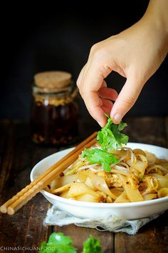 A famous traditional Xi'an dish--Liangpi. Homemade noodle from wheat starch (gluten washed out). With a combined spicy sauce