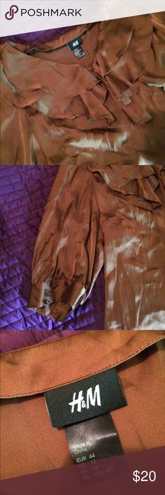 Brown silky ruffle top Brown silky ruffle top, 3/4 sleeve, used a hand full of times, in Excellent Used condition! Perfect addition for work or a party H&M Tops Blouses