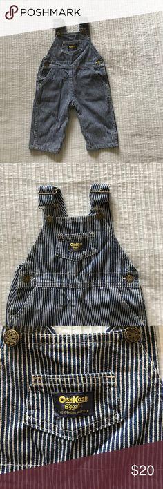 OshKosh B'gosh denim overalls OshKosh B'gosh denim overalls used, but like new! Blue and white pin stripe OshKosh B'gosh One Pieces