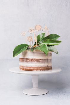 Wooden flower cake toppers from The House That Lars Built for Alexis Mattox Design