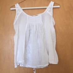 Abercrombie Sheer top Delicate and sheer top from Abercrombie worn once! Has a tie bow in the back and lace detail in the back as well. Pure white color. Abercrombie & Fitch Tops Tank Tops