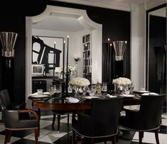 eliware: Ralph Lauren Home glossy black walls, glossy white molding, black dining chairs, oval . Black Leather Dining Chairs, Black And White Dining Room, Black And White Interior, Black Rooms, White Rooms, Black Walls, Black White, White Trim, Ana White