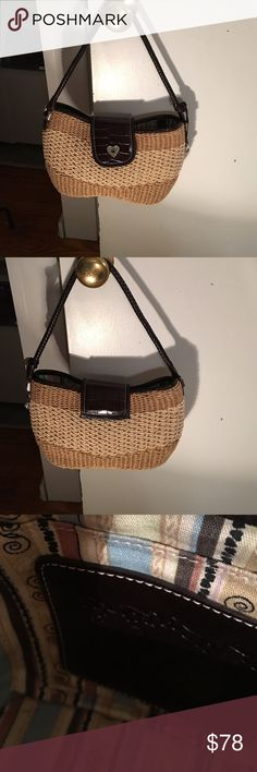 """Brighton Summer Bag Perfect condition Brighton bag in two tone woven jute. Brown leather trim. Braided handle. Silver tone hardware. Two inside slip pockets. Magnetic close. 12"""" x 7"""" x 2"""" with 9"""" handle drop. Iconic hanging heart. Comes with dust bag. Brighton Bags"""