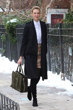 Karlie Kloss smiles brightly in snow covered streets of New York City #dailymail