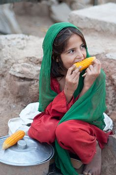 https://flic.kr/p/dbfpgV | In the IDP Camp | This child is selling corn on the roadside in one of the IDP camps near Islamabad.