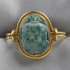 Egyptian Revival 14kt Gold and Scarab Scarf Pin, bezel-set with a faience scarab, 7.5 dwt.