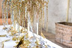 For a simple to put together tabletop display, V V Rouleaux's opulent Champagne Sparkle Amaranthus and Silver Sparkle Amaranthus team wonderfully with Gold Silver Sparkle Maple Garland.