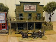 I don't know much about this guy. He scratch builds these awesome 25/28 mm scale buildings for an Old West skirmish game. Not sure if he sells them, but he's built a whole town, it is really impressive work.