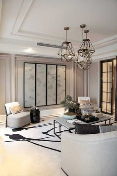 contemporary living room with clean lines | large neutral artwork in white space | contemporary metal overhead lighting | modern residential interior design ideas | modern home decor with Japanese influence