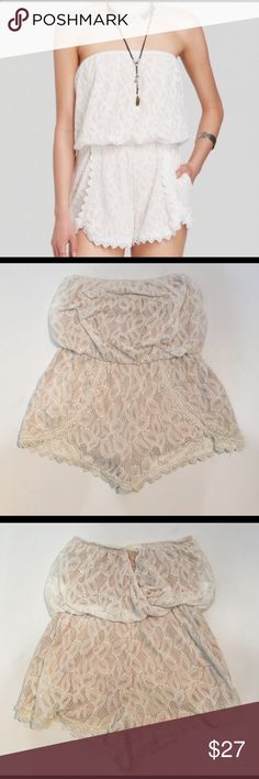 """Free People Tahlia Lace StraplessRomper, S Free People Tahlia Lace Strapless Romper in size small. Features an elasticized top of romper and waistline, keyhole back, and fully lined in beige material. Inseam measures just over 2, and about 22"""" from the center front. She'll is made from 100% nylon and lining is made from 100% rayon. Perfect on its own or as a bathing suit cover. Does not come with straps. This is a preloaded item in good used condition, please ask if you have any questions…"""