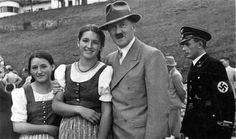 fuehrerbefehl:Hitler posing with two beautiful young women at the Berghof