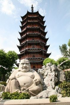 Ancient Buddha Pagoda in Suzhou, China.  He looks so happy.  But, where's his shirt?  He left it at home!
