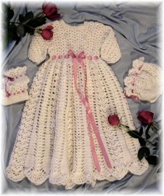 Creations by Rebecca Leigh and littlebuddydolls. Baby Christening Gown, Bonnet and Booties. For size Newborn to 6 months.    Can be made with LONG OR SHORT SLEEVES.....    Make it in Baby Sports Weight yarn #3    Also can be made in SuperFine #1 for Newborn Size 16 to 17 inch chest - Newborn to 6 months - 5 to 10 lbs. Materials: 4 - 5 ounce skeins of Red Heart Light TLC Baby Sports Weight Yarn (141 gms - 360 yds - 329 m each) 2.75mm steel crochet hook or size to obtain gauge 3 - Velcro…
