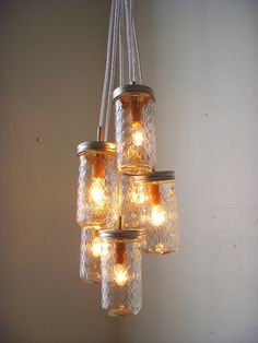 Dazzling Diamonds Mason Jar Chandelier - Upcycled Hanging Lighting Fixture Featuring Pint Sized Quilted Jelly Jars - Rustic BootsNGus Design by BootsNGus on Etsy https://www.etsy.com/listing/69461452/dazzling-diamonds-mason-jar-chandelier