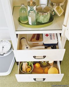 Toiletry Organizer - If you can, choose cabinets that offer separate spaces -- preferably one for each person who uses the bathroom. In this refurbished antique, the bottom drawer contains the kids' bath toys, while the top one holds mom's hair-care essentials, plus a first-aid kit. A lazy susan makes accessing toiletries, stored in pretty clear containers, a snap.