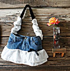 repurposed Hang Ten denim skirt with ruffles and bows. Happiness is!!   : )