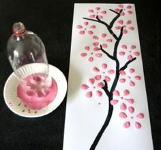 Really cute idea for making cherry blossoms on a painting for a bedroom..try them in red! The flower is made by the bottom of the liter bottle dipped in paint. Great craft for the kids too! doing this tomorrow